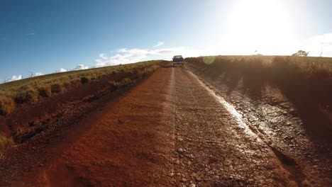 POV-from-the-front-of-a-vehicle-following-a-pickup-truck-on-a-very-rutted-dirt-road-on-Molokai-Hawaii-from-Maunaloa-to-Hale-o-Lono