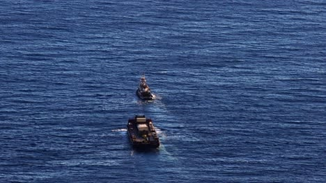 A-once-a-year-barge-with-goods-and-supplies-arrives-on-the-Hawaiian-island-of-Molokai-to-the-port-of-Kalaupapa-Hawaii