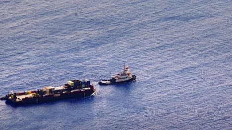 A-once-a-year-barge-with-goods-and-supplies-arrives-on-the-Hawaiian-island-of-Molokai-to-the-port-of-Kalaupapa-Hawaii-2