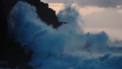 Extreme-slow-motion-of-beautiful-ocean-waves-crashing-into-Kaiaka-Rock-Molokai-Hawaii-3