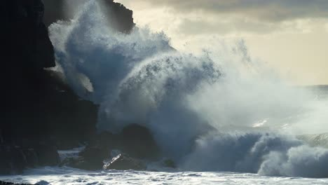 Extreme-slow-motion-of-beautiful-ocean-waves-crashing-into-Kaiaka-Rock-Molokai-Hawaii-8