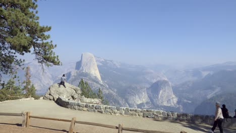 People-view-Half-Dome-and-the-High-Sierra-Mountain-Range-from-Washburn-Point-Yosemite-National-Park-California-1