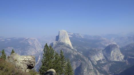 Horizontal-pan-Half-Dome-and-the-High-Sierra-Mountain-Range-from-Washburn-Point-Yosemite-National-Park-California