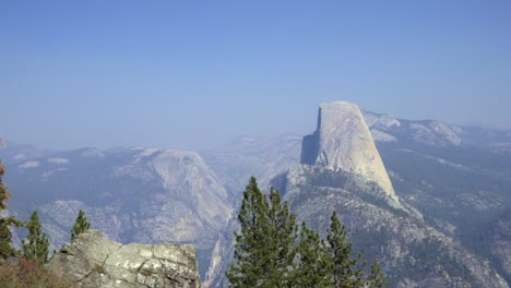 Horizontal-pan-Half-Dome-and-the-High-Sierra-Mountain-Range-from-Washburn-Point-Yosemite-National-Park-California-1