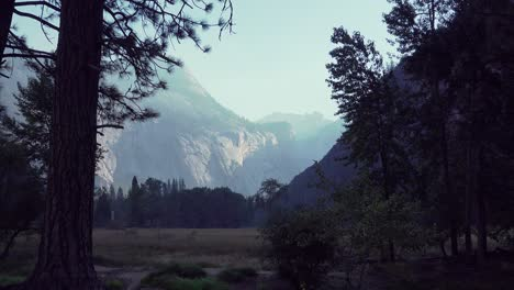 Zoom-out-of-early-morning-light-raking-across-a-granite-wall-in-the-Yosemite-Valley-Yosemite-National-Park-California