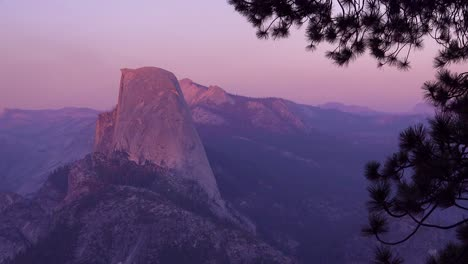 Magenta-alpen-glow-after-sunset-on-Half-Dome-and-High-Sierra-Nevada-Mountains-from-Washburn-Point-Yosemite-NP