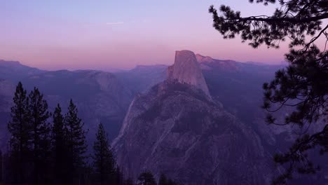 Magenta-alpen-glow-after-sunset-on-Half-Dome-and-High-Sierra-Nevada-Mountains-from-Washburn-Point-Yosemite-NP-1