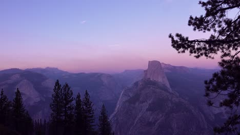 Magenta-alpen-glow-after-sunset-on-Half-Dome-and-High-Sierra-Nevada-Mountains-from-Washburn-Point-Yosemite-NP-2