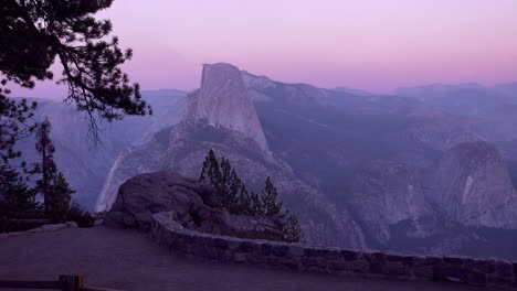 Magenta-alpen-glow-after-sunset-on-Half-Dome-and-High-Sierra-Nevada-Mountains-from-Washburn-Point-Yosemite-NP-3
