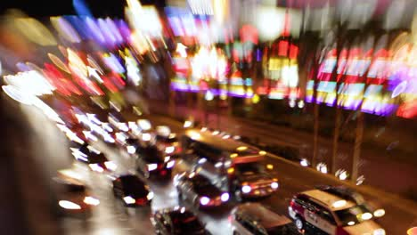 Selective-focus-image-of-the-electricity-and-energy-of-bright-lights-and-traffic-on-the-strip-at-night-in-Las-Vegas-Nevada