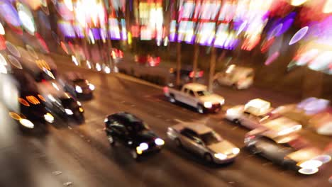 Selective-focus-image-of-the-electricity-and-energy-of-bright-lights-and-traffic-on-the-strip-at-night-in-Las-Vegas-Nevada-2