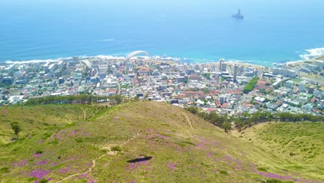 Drone-aerial-over-paragliding-and-paragliders-with-the-downtown-city-of-Cape-Town-South-Africa-in-background
