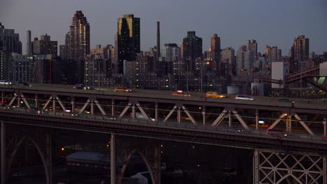 Night-shot-of-traffic-on-the-Queensboro-Bridge-with-New-York-Manhattan-skyline-background-1