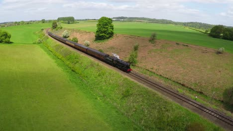 An-aerial-of-a-steam-train-as-it-passes-through-the-English-countryside-at-high-speed-1