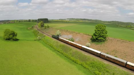 An-aerial-of-a-steam-train-as-it-passes-through-the-English-countryside-at-high-speed-3