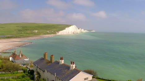Areal-shot-of-beautiful-houses-along-the-shore-of-the-White-Cliffs-of-Dover-at-Beachy-Head-England-1