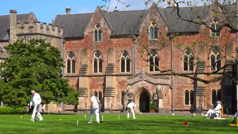 Seniors-play-croquet-on-the-grounds-of-an-elaborate-mansion-in-Great-Britain-2