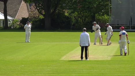 The-sport-of-cricket-is-played-on-a-green-grass-pitch-in-England