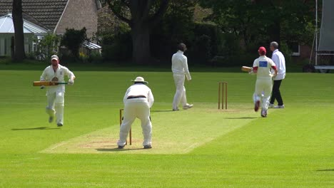 The-sport-of-cricket-is-played-on-a-green-grass-pitch-in-England-1
