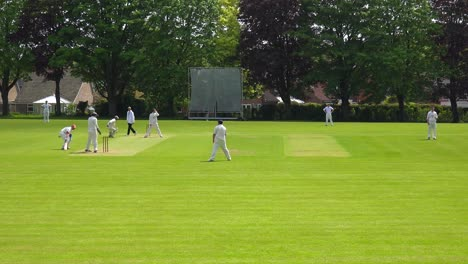 The-sport-of-cricket-is-played-on-a-green-grass-pitch-in-England-2