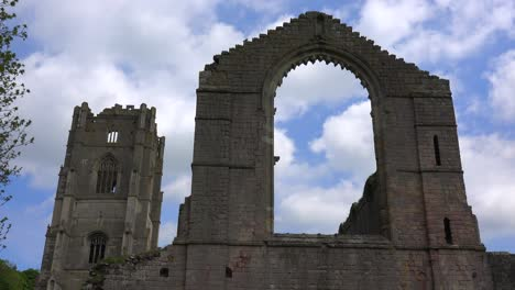 A-timelapse-shot-of-clouds-moving-behind-Fountains-Abbey-in-England