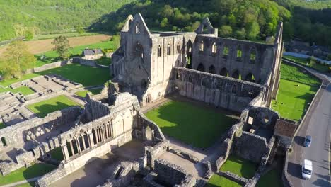 An-amazing-aerial-view-over-the-abandoned-Tintern-Abbey-in-Wales-United-Kingdom