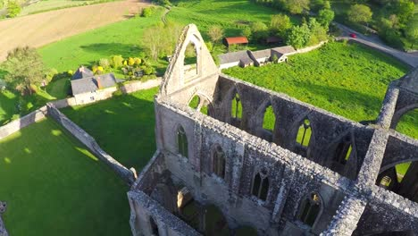 An-amazing-reverse-reveal-aerial-view-over-the-abandoned-Tintern-Abbey-in-Wales-United-Kingdom