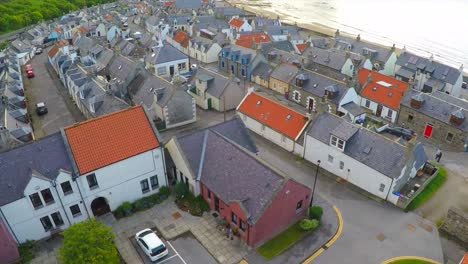 An-aerial-over-a-quaint-fishing-village-in-Northern-Scotland