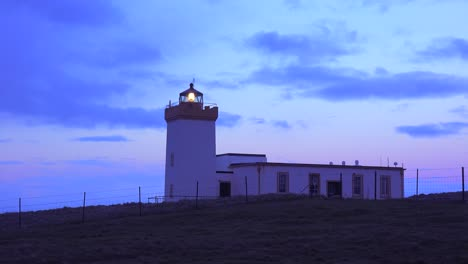 A-lighthouse-beams-a-light-out-from-the-northernmost-point-in-Scotland