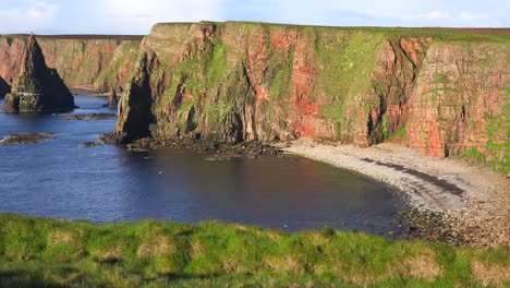 Panning-shot-of-the-beautiful-Duncansby-Head-sea-stacks-in-Northern-Scotland