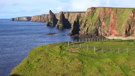 Establishing-shot-of-the-beautiful-Duncansby-Head-sea-stacks-in-Northern-Scotland-1