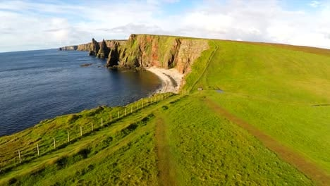 Aerial-shot-of-the-beautiful-Duncansby-Head-sea-stacks-in-Northern-Scotland