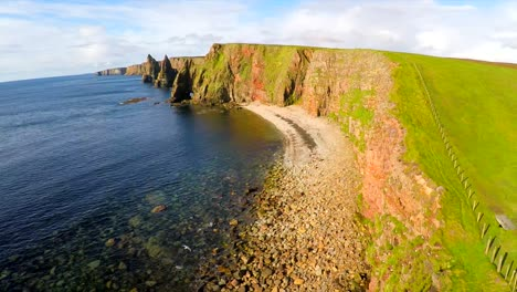 Aerial-shot-of-the-beautiful-Duncansby-Head-sea-stacks-in-Northern-Scotland-1