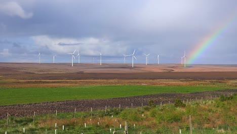 A-beautiful-rainbow-forms-near-wind-generation-windmills-in-Northern-Scotland