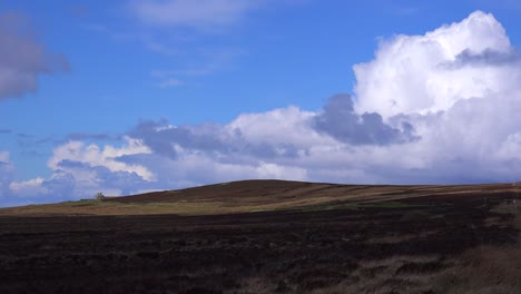 A-small-abandoned-stone-house-is-seen-in-the-distance-across-the-beautiful-Scottish-moors-1