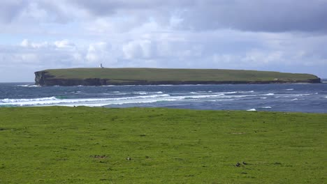 A-lighthouse-sits-on-a-remote-island-near-the-Orkney-Islands-of-Scotland