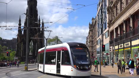 An-establishing-shot-of-a-tram-passing-on-the-streets-of-the-Edinburgh-Scotland