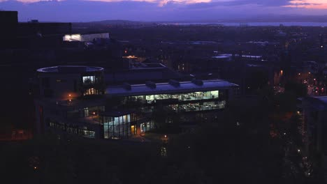 An-establishing-shot-of-a-modern-office-building-in-Edinburgh-Scotland-at-night