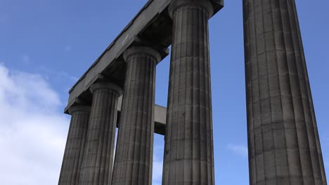 An-establishing-time-lapse-shot-of-the-Roman-columns-in-Edinburgh-Scotland-at-night