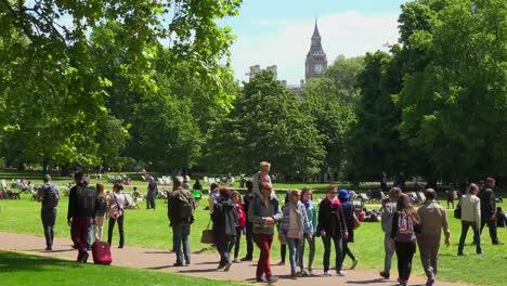 Pedestrians-walk-in-St-James-Park-in-London-with-Big-Ben-background