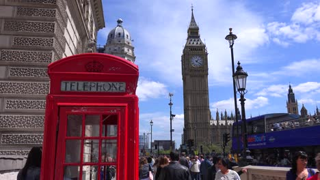 An-iconic-red-telephone-booth-in-front-of-Big-Ben-and-Houses-Of-Parliament-in-London-England
