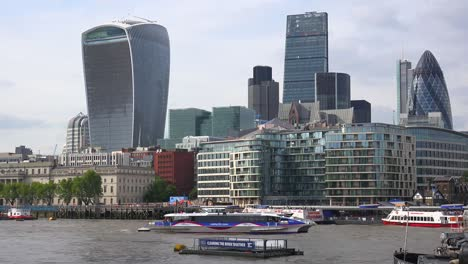 An-establishing-shot-of-the-Walkie-Talkie-and-other-business-buildings-along-the-River-Thames-in-downtown-London-England