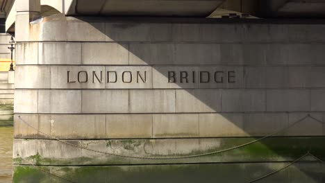 A-view-from-a-boat-passing-under-London-Bridge-England