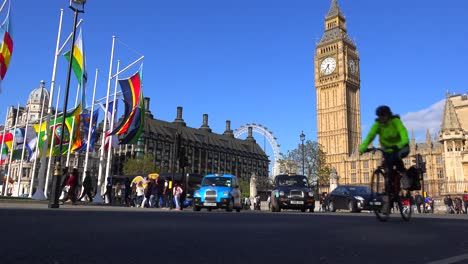 London-taxis-pass-Big-Ben-and-Westminster-Abbey-England-1