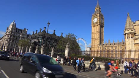 Doubledecker-bus-passing-Big-Ben-and-Westminster-Abbey-England-1