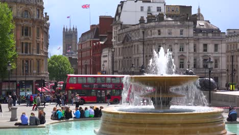 An-establishing-shot-of-Trafalgar-Square-London-England-with-fountain-foreground