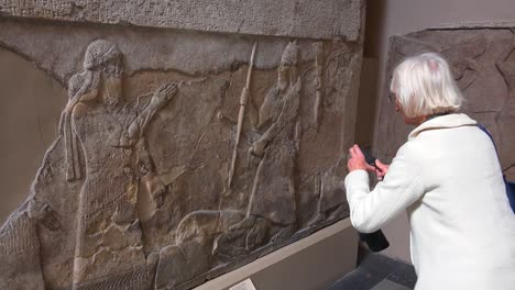 Visitors-to-the-British-Museum-admire-carvings-and-artifacts-excavated-at-Nimrud-Iraq