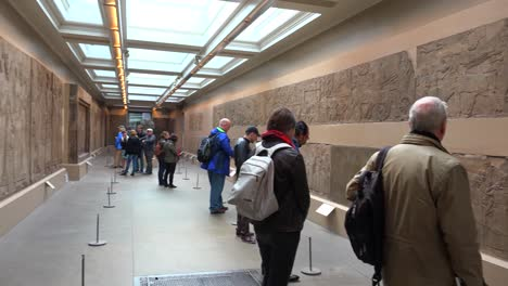 Visitors-admire-famous-ancient-carvings-and-artifacts-excavated-at-Nimrud-Iraq-now-in-the-British-Museum-London