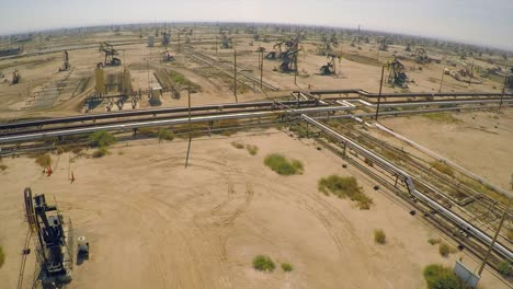 Amazing-aerial-shot-over-vast-oil-fields-and-derricks-near-Bakersfield-California-2