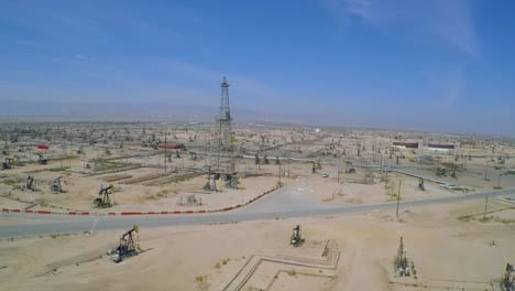Amazing-aerial-shot-over-vast-oil-fields-and-derricks-near-Bakersfield-California-3